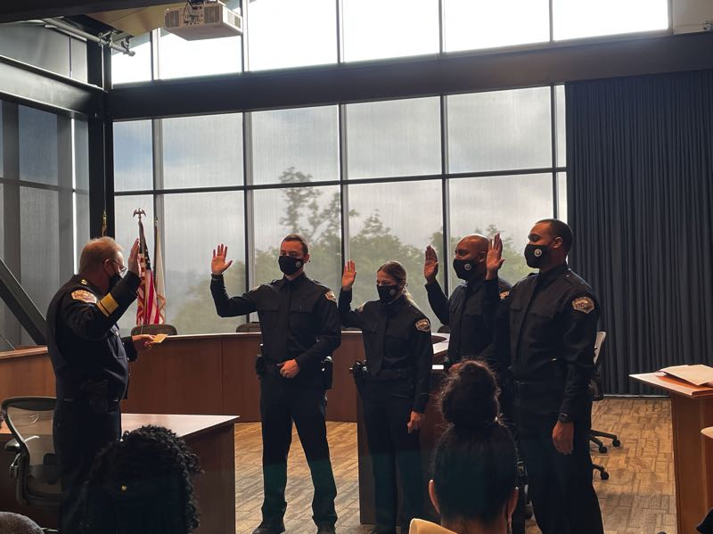 COURTESY PHOTO: TOM HAMANN - Four new police officers are sworn in.