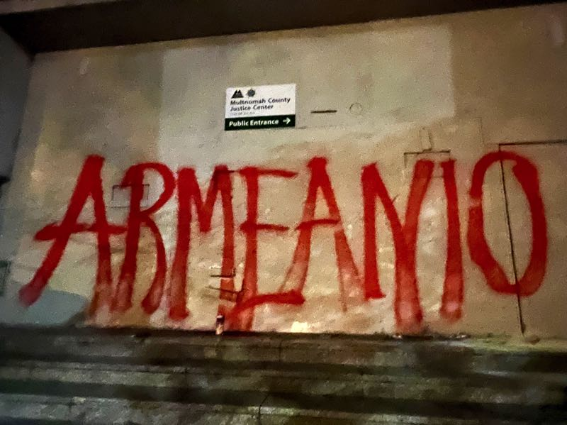 PMG PHOTO: ZANE SPARLING - The front doors of the Multnomah County Justice Center remain walled-up, but protesters spray-painted on them the word Armeanio, a reference to one of Sean Kealiher's aliases.