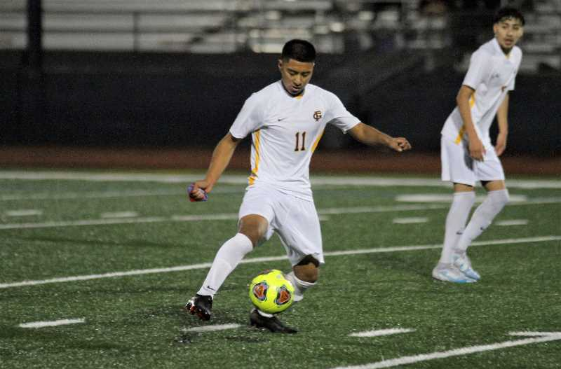PMG PHOTO: WADE EVANSON - Forest Grove's Abraham Alvarez dribbles the ball during the Vikings' game with Glencoe Tuesday night, Oct. 12, at Hare Field in Hillsboro. Alvarez scored two goals in the game.