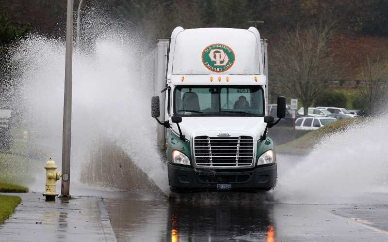 PMG FILE PHOTO: JONATHAN HOUSE - A truck plowed through a flooded Milwaukie street after record rainfall in December 2015.