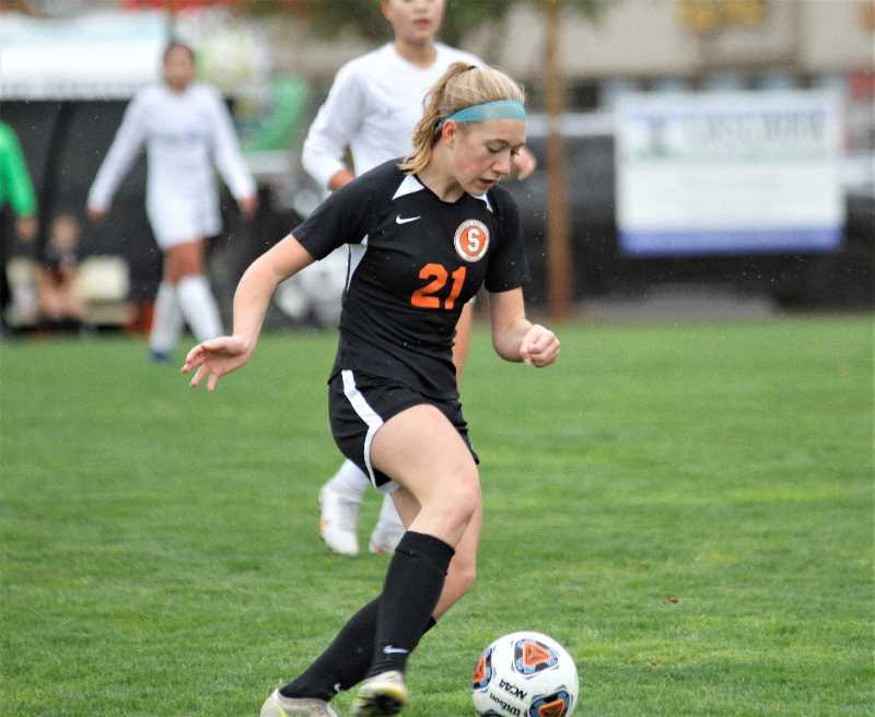 PMG PHOTO: WADE EVANSON - Scappoose freshman defender Payton Hamman dribbles the ball during the Indians' game against Hillsboro Tuesday afternoon, Oct. 12, at Chinook Field in Scappoose.