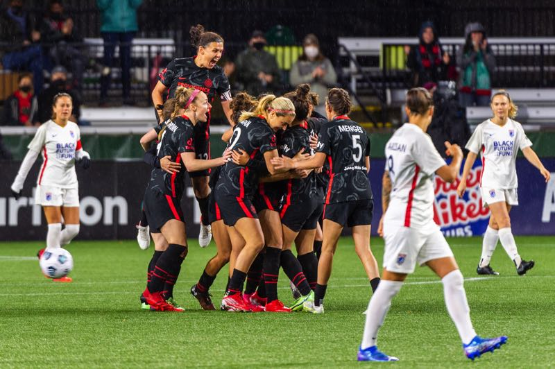 PMG PHOTO: DIEGO G. DIAZ - Thorns players, including a jumping Christine Sinclair, mob Morgan Weaver after Weaver's third-minute goal gave Portland an lead on Wednesday at Providence Park.