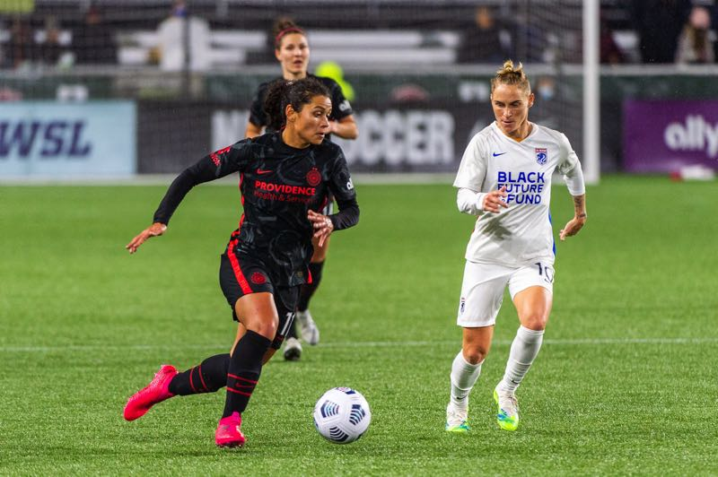 PMG PHOTO: DIEGO G. DIAZ - Thorns midfielder Rocky Rodriguez dribbles up field on Wednesday as OL Reign's Jessica Fishlock chases. Portland and OL Reign played to a 1-1 draw at Providence Park.