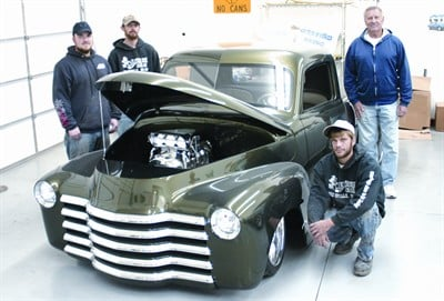 by: JASON CHANEY/CENTRAL OREGONIAN - RK Restorations owner Bob Komlofske, and his staff pose with the award-winning 1953 Chevy pickup they restored during the past four years. The vehicle, which is owned by Komlofske, has won multiple accolades in car shows throughout the United States. Pictured left to right are Scott Hughes, Dusty Brock, Komlofske, and Brent Rockwood.