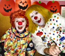 "by: Carol Hazzard, ""Caring Clowns"" Lenore (left) and Bud Frimoth posed recently in a local preschool class, in which they had applied their makeup in front of the children both to show how it is done, and to avoid frightening them by walking in as clowns. ""Yes, we are real people,"" they assured the class."