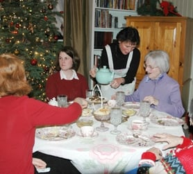 by: Courtesy Photo, Forest Grove resident Laura Frye (center) pours tea for women who attended a fund-raiser in the home of Carol Drew last week to raise money for PEO scholarships.