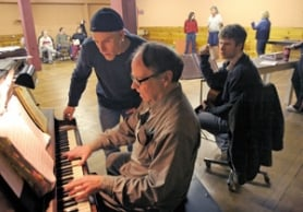"by: JIM CLARK, Dale Johannes, who plays Tonya Harding's one-time husband Jeff Gillooly, talks with company pianist Bill Wells during a rehearsal of ""Tonya and Nancy: The Rock Opera,"" which was inspired by the two Olympic figure skaters."