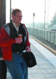 by: Leah Weissman, WES RIDER – Tigard resident David Leinberger (left) waits for a WES commuter rail Monday at the Tigard station.