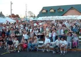 by: staff file photo, Hundreds of people celebrate together in a previous year during the concerts offered in Sandy's Civic Plaza as a part of the annual Music Fair and Feast — held this year Thursday through Sunday, July 9-12.