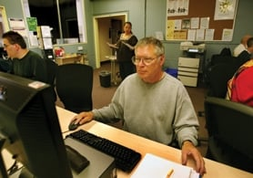 by: L.E. Baskow, George Snipes uses a computer at WorkSource Oregon to search for possible job openings in the Portland area. The Vietnam veteran was laid off last November and now is applying for part-time work.