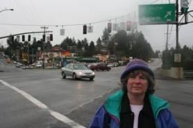 by: Shasta Kearns Moore, Transportation advocate Marianne Fitzgerald stands at the West Portland Crossroads, which she and others are trying to revitalize in anticipation for Barbur Boulevard being named Metro's next top priority for high-capacity transit, which could well mean light rail.
