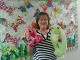by: Courtesy photo GIVING — CASA for Kids volunteer Donna Holmes poses with stuffed animals that were donated to CASA this summer by children at the Grace Lutheran Church's Vacation Bible School.