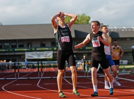 by: DAN BROOD, THE BEST — Tigard senior Sean McGetrick (left) rejoices after winning the 300 intermediate hurdles.
