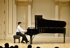 by: SUBMITTED - Where dreams come true - 14-year-old Newberg resident Nathan Kim performs Liszt's Hungarian Rhapsody No.15 in A minor during the     winner's recital of the American Fine Arts Festival International Concerto Competition at Carnegie Hall in New York City. Kim was one of three musicians awarded the competitions grand prize.