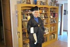 by: BARBARA SHERMAN - BLAZING A NEW TRAIL - Velda Metelmann tries on her cap and gown for the first time in anticipation of her graduation ceremony at Marylhurst University.