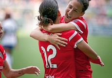 by: TRIBUNE PHOTO: JONATHAN HOUSE - Portland Thorns Christine Sinclair (left) and Veronica Boquete celebrate a goal in Sundays 7-1 homefield victory over FC Kansas City.