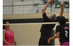 by: COREY BUCHANAN - Doyle Tracy delivers a set for a teammate during the North Marion Volleyball Tournament.