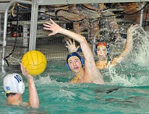 by: GARY ALLEN - Human shields - Tyler Bell (front) and Kyle Hansen attempt to block a shot during the Oregon State Games Sunday at the Multnomah Athletic  Club in Portland. The Chehalem Water Polo Club went 4-0 at the tournament to win the Open Division championship.