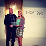by: SUBMITTED PHOTO - Bob Warmbold, owner of Accent Lighting in Lake Oswego, is pictured receiving the Showroom of the Year award for Exceptional Commmunity Involvement at the Dallas International Lighting Market.