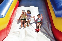 by: TIMES PHOTO: JOHN LARIVIERE - Get ready for fun, games and giant inflatables at the ninth annual Party in the Park on Saturday, July 26, at the Howard M. Terpenning Recreation Complex in Beaverton.