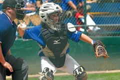 by: THE OUTLOOK: DAVID BALL - Gresham catcher Reece McKenzie pops out of his stance to challenge a base runner during the teams 10-0 win over Corvallis in the opening game at the state Little League tournament Friday.