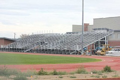 by: JEFF WILSON/THE PIONEER - Construction on the bleachers at the new Madras High School sports stadium continues. The facility should be complete by the White Buffalos' season opening football game on Sept. 12.