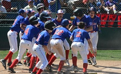 by: TIMES PHOTO: MATT SINGLEDECKER - The Cedar Mill 11-12 All-Stars celebrate James Porters solo shot to left in the sixth inning of the squads 6-5 loss to Grants Pass on Friday.