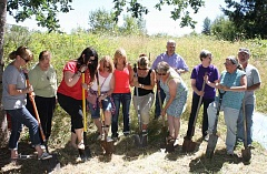 by: PEGGY SAVAGE - Volunteers man their shovels during the Bear Creek Byway groundbreaking ceremony Saturday.