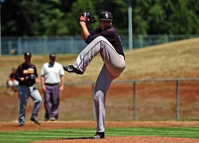 by: DAN BROOD - NO RUNS -- Sherwood's Zak Taylor shut out Oregon City on two hits in the team's 8-0 OIBA tourney win on Friday.