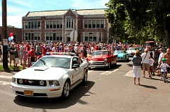 by: DAVID F. ASHTON - The 2014 Eastmoreland July 4th Parade rolls out from the Duniway School staging area.