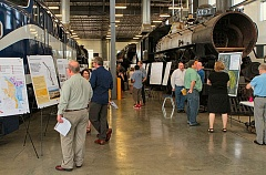 by: DAVID F. ASHTON - At the Southeast Quadrant Plan open house, visitors browse exhibits, dwarfed by locomotives in the Oregon Rail Heritage Center, where the meeting was held.