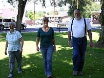 Photo Credit: JASON CHANEY - From left, Carrol Landis, Karen Yeargain and Bob Orlando complete laps around Pioneer Park during a Walk with Ease class.