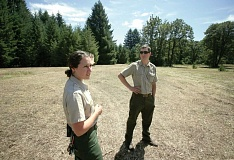 Photo Credit: TRIBUNE PHOTO: JONATHAN HOUSE - Oregon State Park Rangers Lauren Sinclair and Guy Rodrique talk about the original Vortex Festival, held at Milo McIver State Park in August 1970. A retrospective of the event is planned Saturday, Aug. 9 at the Estacada-area park.
