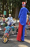 Photo Credit: RAY HUGHEY - The Aurora Colony Days Parade, which starts at 11 a.m., features children on bikes and even a man on stilts.