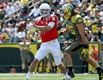 Photo Credit: COURTESY OF ERIC EVANS - Jeff Lockie sets up to pass during the Oregon Ducks' 2013 spring game.