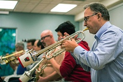 Photo Credit: TIMES PHOTO: LACEY JACOBY - Trumpeters practice during a rehearsal at the Juanita Pohl Center in Tualatin. The musicians pay $7 a week to be part of the band, with money simply going toward buying music.