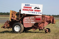 Photo Credit: NEWS-TIMES PHOTO: DOUG BURKHARDT - Local residents are gearing up for the annual Banks Bar-B-Que, which features a whole lot more than good home cooking. This combine on Highway 26 between North Plains and Banks sets the spirit for commuters. The Texas Holdem poker tournament will be held Friday, Aug. 15, and the tractor and truck pulls happen Saturday, Aug. 16 and Sunday, Aug. 17. The crowd-favorite combine destruction derby and much-loved parade are grand finales set for Sunday. Visit bankssunsetpark.com for a complete schedule of old-fashioned fun.