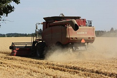 Photo Credit: HILLSBORO TRIBUNE PHOTO: DOUG BURKHARDT - A team from Finegan Farms in Cornelius was busy with a combine harvesting wheat from a parcel of land alongside Highway 26 near North Plains over the weekend. Approximately 90 percent of the wheat harvested in Oregon is exported, mostly to Asian markets.