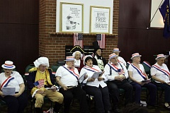 Photo Credit: HILLSBORO TRIBUNE PHOTO: DOUG BURKHARDT - Ten residents of the Rosewood Park Retirement & Assisted Living Residence in Hillsboro presented America, the Story of Us, Sunday afternoon. Members of the Rosewood Choir, accompanied by a pianist, performed several patriotic songs, including God Bless America, America the Beautiful, My Country Tis of Thee and several other iconic American tunes. About 50 people attended the free public event in Rosewoods Emperor Room. Sundays presentation, which was the second performance of the program by the Rosewood Choir last week, helped raise funds for the Alzheimers Association of Portland. With the choirs performance and other recent activities, Rosewood Park has raised more than $6,000 for Alzheimers research.