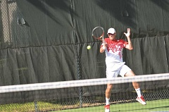 Photo Credit: COREY BUCHANAN - 2009 US Open mixed doubles champion and 2001 NCAA men's doubles champion Travis Parrott rips a forehand.