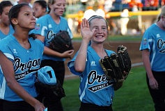 Photo Credit: DAN BROOD - ALWAYS SMILING -- Tigard/TC shortstop Bella Valdes waves to a fan in the grandstands during Friday's game at the Little League Softball World Series.