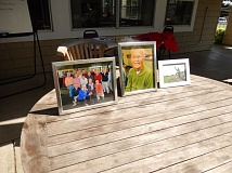 Pictures of Doug Oliphant sat near the clubhouse at Lake Oswego Golf Course during the inaugural Oliphant Tournament.