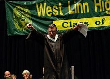 Photo Credit: VERN UYETAKE - Ward Lewis was selected as West Linn's teacher of the year and addresses students during graduation.