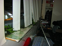 Photo Credit: WASHINGTON COUNTY SHERIFF'S OFFICE - Inside of apartment damaged by crash during parking.