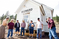 Photo Credit: KEVIN SPERL - Sharon Allured (far left), Val Grubbe, Bill Grubbe, Gerry Grubbe, Lucy Woodward, Bill Quant, and Merle Williams reminisce about their school years in front of the recently relocated Howard School building.