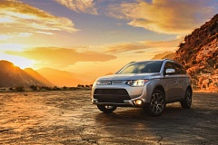 Photo Credit: MITSUBISHI MOTORS - The 2015 Mitsubishi Outlander sports a new aggressive grill  and available GT package.