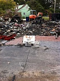 Photo Credit: STAFF PHOTO: BARB RANDALL - The Crab Pot, the Lincoln City business of Allen Black, , burned July 3. All that remains were a few signs, such as this one. Black wants to rebuild and continue selling Oregons fish.