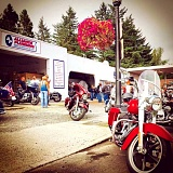 Photo Credit: CONTRIBUTED PHOTO - Motorcyclists gather at Alliance Plumbing in downtown Troutdale for a 100-mile ride to fund cancer research.