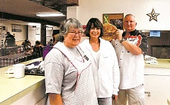 The flapjacks were flying Saturday, Aug. 9, during the Aurora Unit 110, American Legion Auxiliary's annual pancake feed at the Aurora Colony Days celebration. (From left) Pam Seelye, Debbie and Dirk Levy enjoy a brief break from the action in the kitchen during the pancake feed. In all, the event fed 160 adults, 17 children and 20 vendors. Legion Post 110 Commander Seth Fisher and Sons of the American Legion Squadron Detachment Commander Brian Mulbey organized a crew to serve breakfast to the Main Street vendors early Saturday morning.