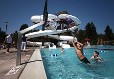 Photo Credit: TIMES PHOTO: JONATHAN HOUSE - Two boys break in the basketball hoop in one of the outdoor pools at VillaSport Athletic Club and Spa on Monday, the opening day of the resort-like facility at Southwest Murray Boulevard and Jenkins Road.